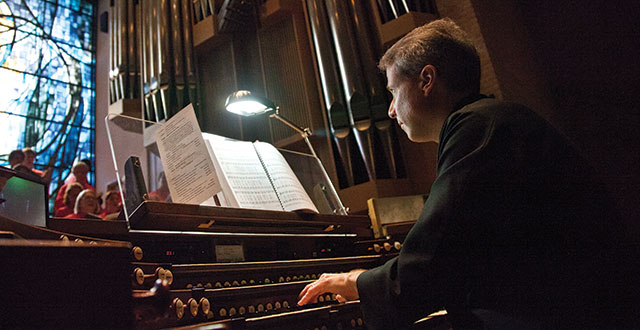 James Diaz, the director of music at St. Michael and All Angels Episcopal Church, plays the organ. Photo by Kim Leeson