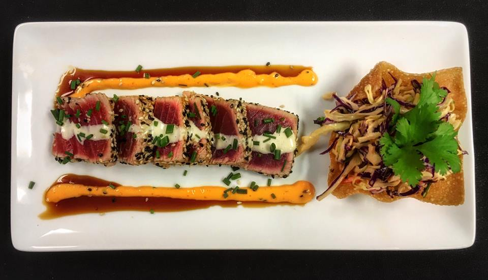 Sesame crusted ahi tuna with sweet soy glaze and wasabi aoli, served with shaved cabbage slaw and crispy wonton. Photo via Sevy's Grill —Facebook