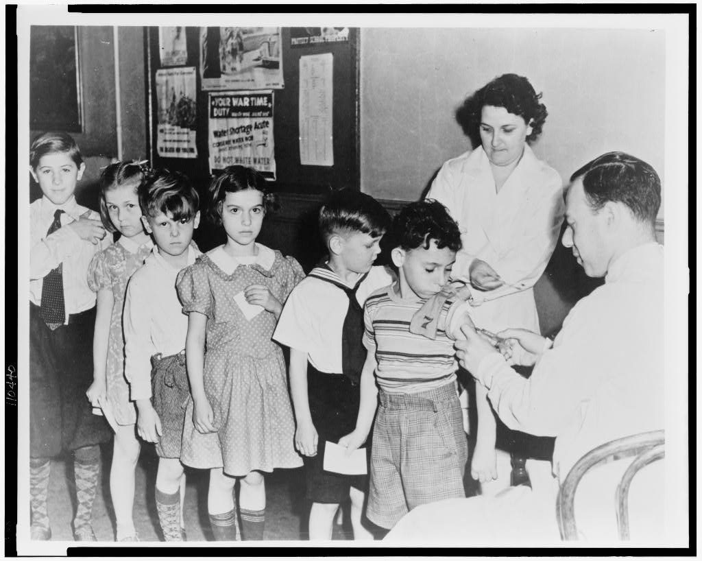 Schoolchildren wait in line for immunization shots at a child health station in New York City, N.Y., in 1944. (Photo courtesy of the Library of Congress)