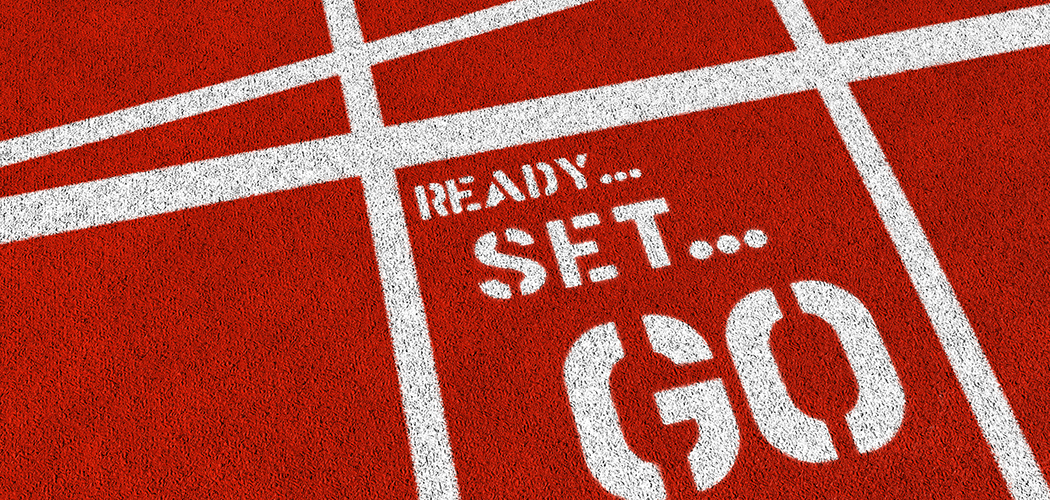 The words READY SET GO on an athletics track.