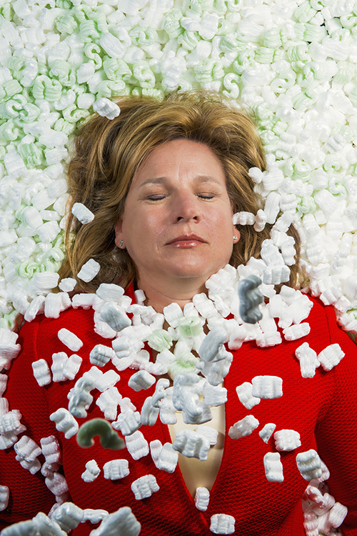 Dallas City Councilman Jennifer Staubach Gates buried in packing peanuts