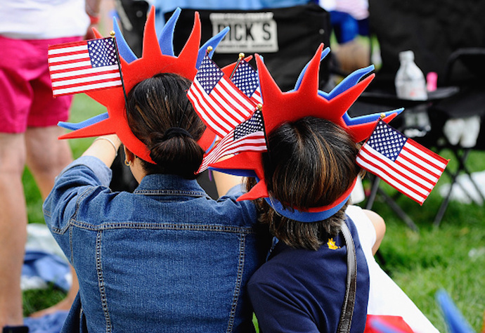BOSTON, MA - JULY 04: Festive hats as thousands attend the Boston Pops Fourth Of July Fireworks Spectacular amid heightened security at Hatch Shell on July 4, 2015 in Boston, Massachusetts. (Photo by Paul Marotta/Getty Images)